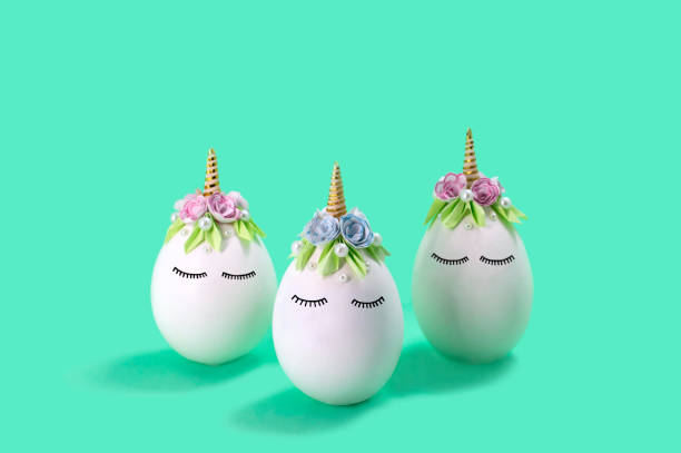 Three cute handmade unicorns made of eggs. Easter concept stock photo