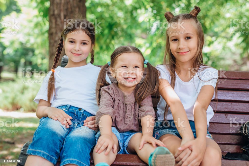Groovy Three Cute Little Girls Smiling And Sitting On The Wooden Bralicious Painted Fabric Chair Ideas Braliciousco