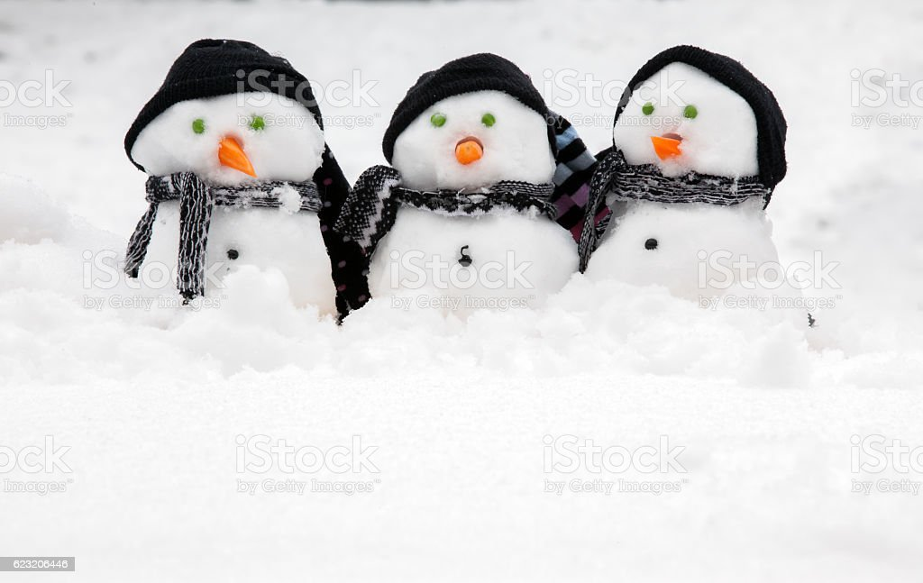 Three cute snowmen with copy space stock photo