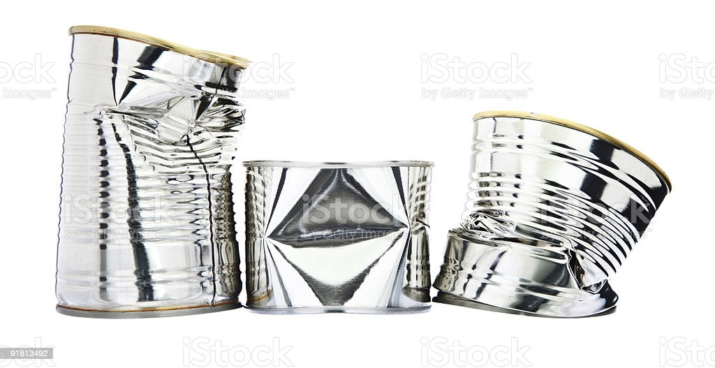 Three damaged metallic tin cans stock photo