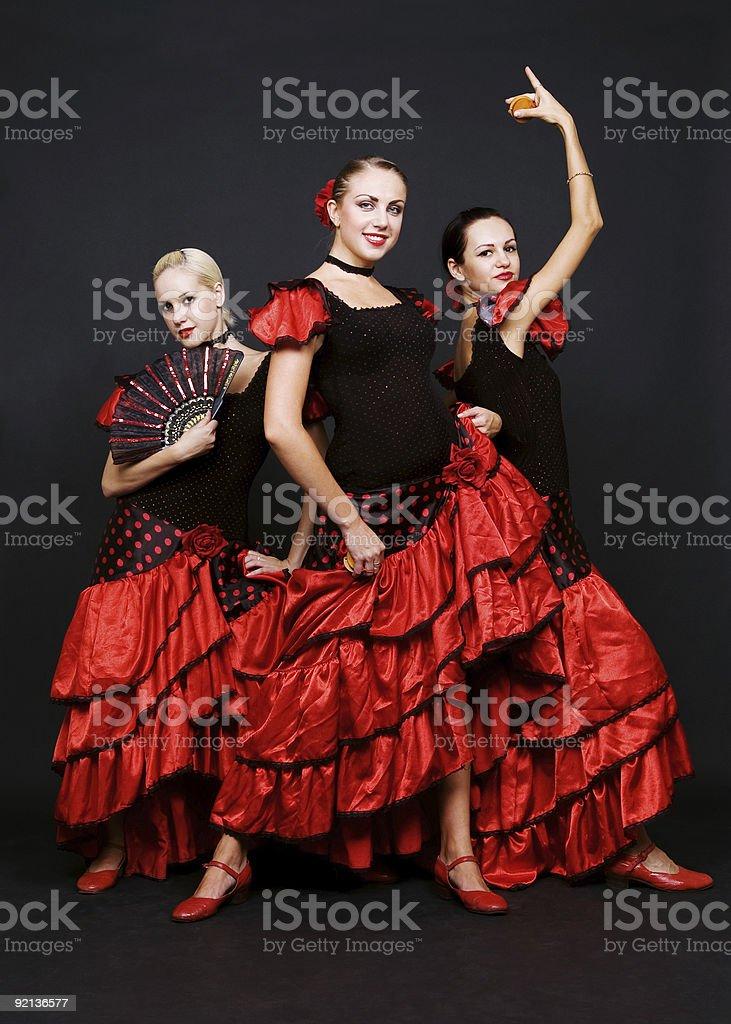 three dancers in spanish dresses royalty-free stock photo