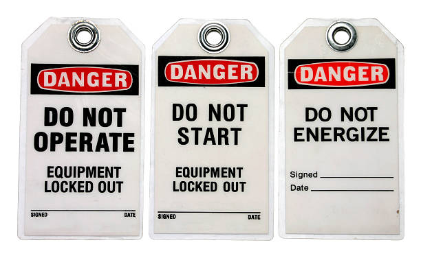 Three danger lockout tags about equipment Lockout Tagout Tags lockout stock pictures, royalty-free photos & images