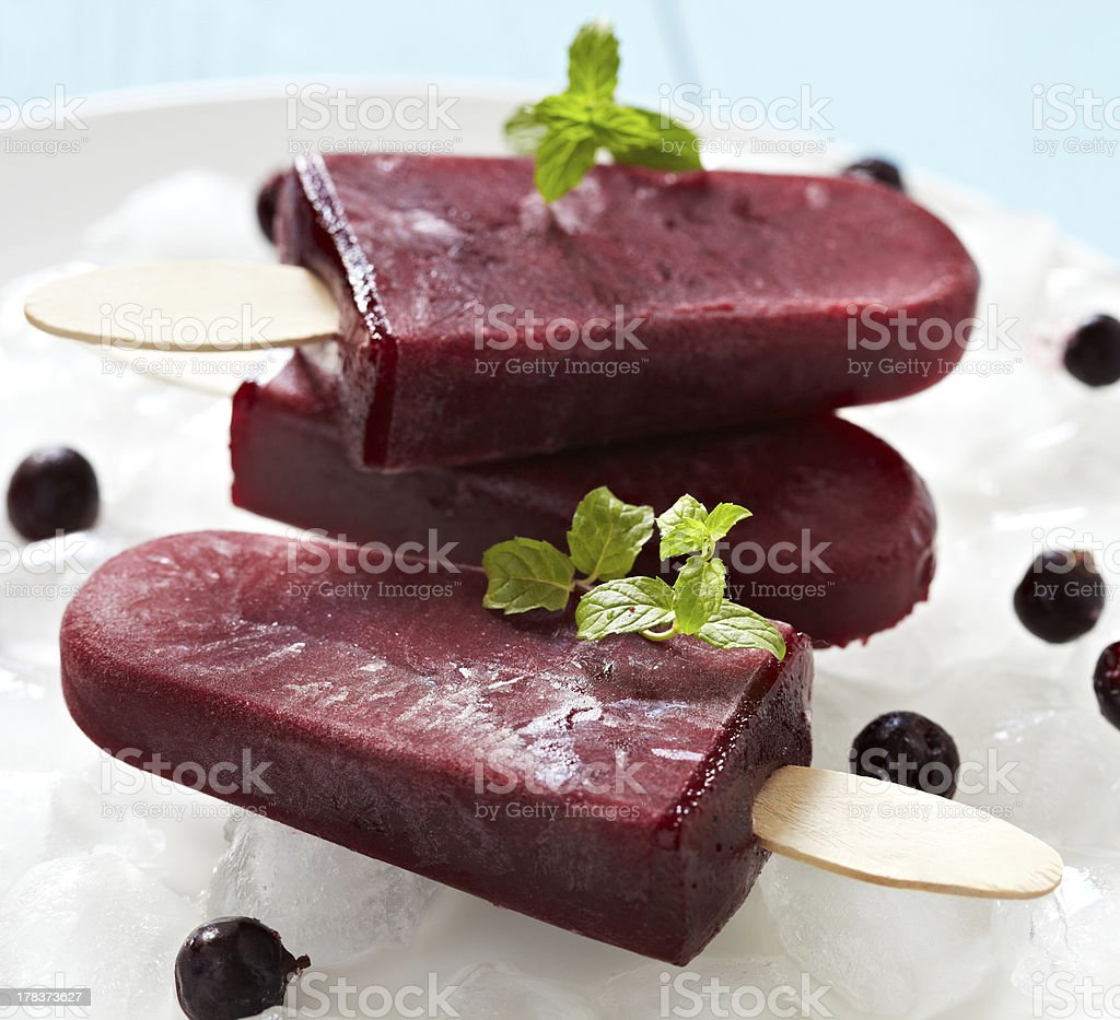 Three dark red ice pops with garnish royalty-free stock photo