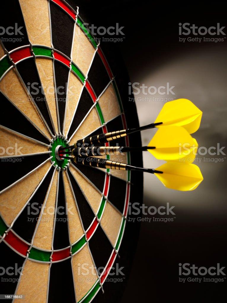 Three Darts in a Bull's Eye royalty-free stock photo