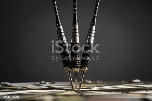 istock Three darts in the center of the target 650619736