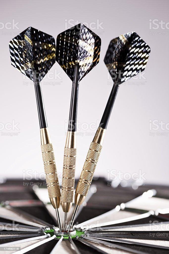 Three darts on a dartboard royalty-free stock photo
