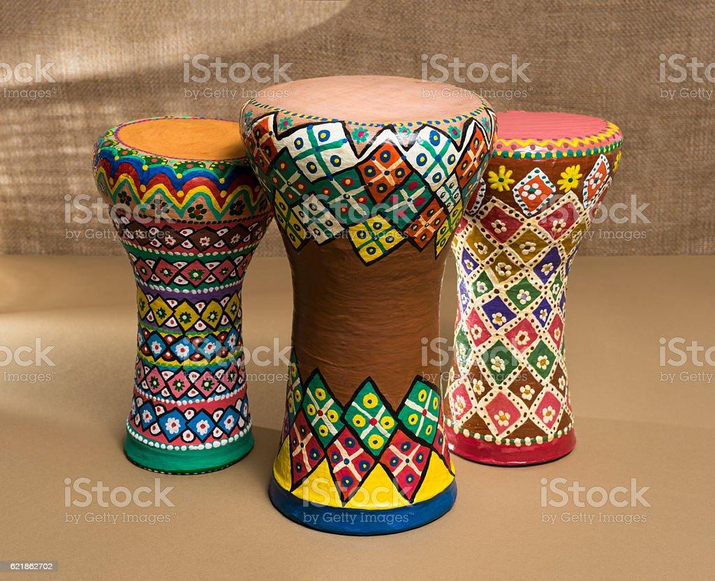 Three decorated colorful pottery goblet drums (chalice drum, tarabuka, darbuka) stock photo