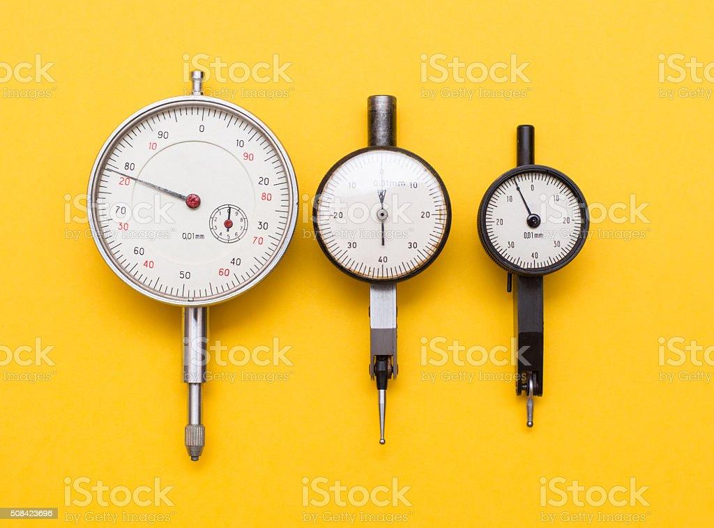 Three depth gauges on yellow stock photo