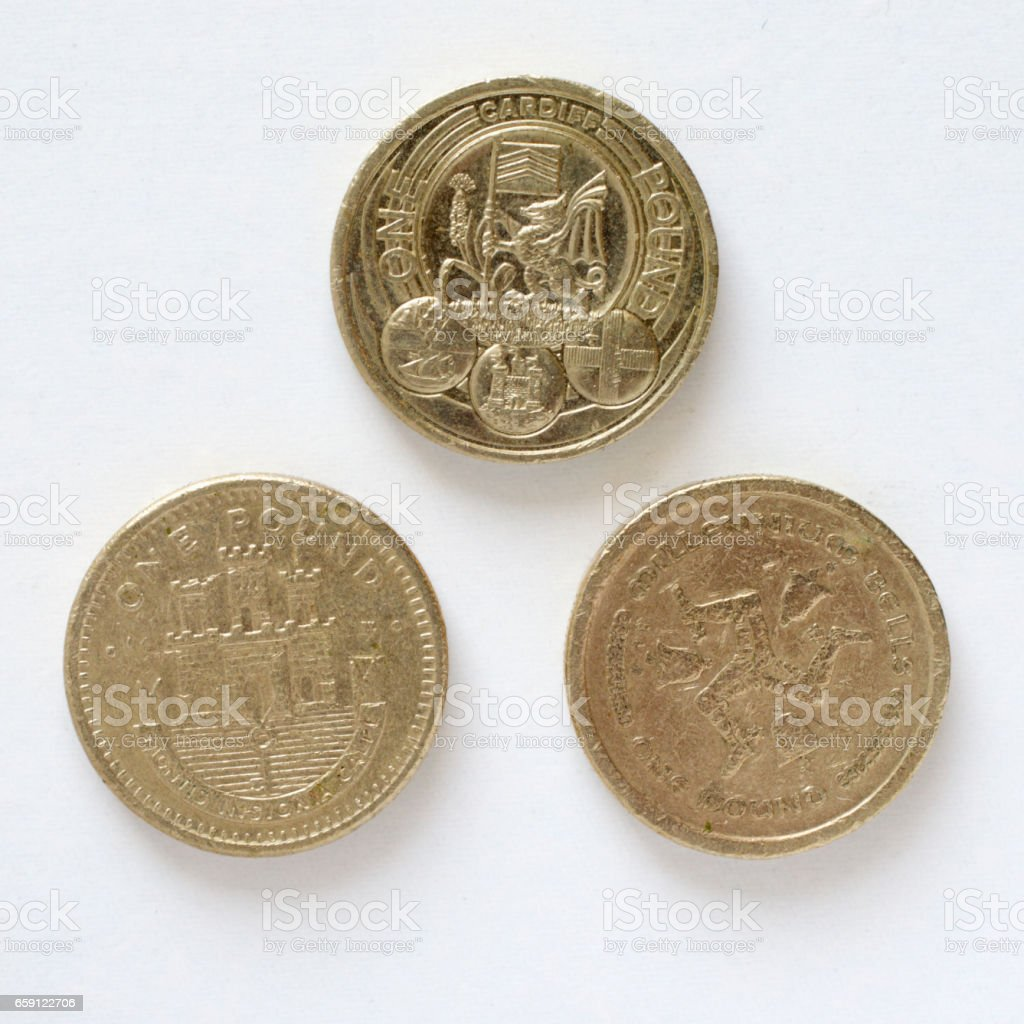 Three designs on British pound coins Gibraltar stock photo