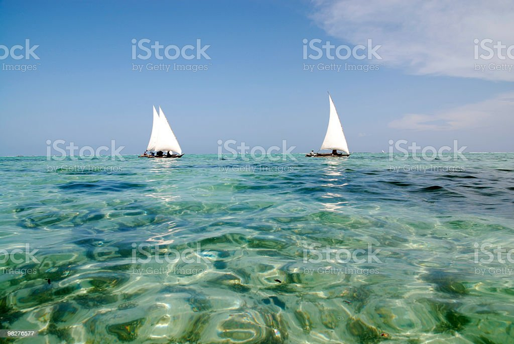 three dhows on the way to catch some fish royalty-free stock photo