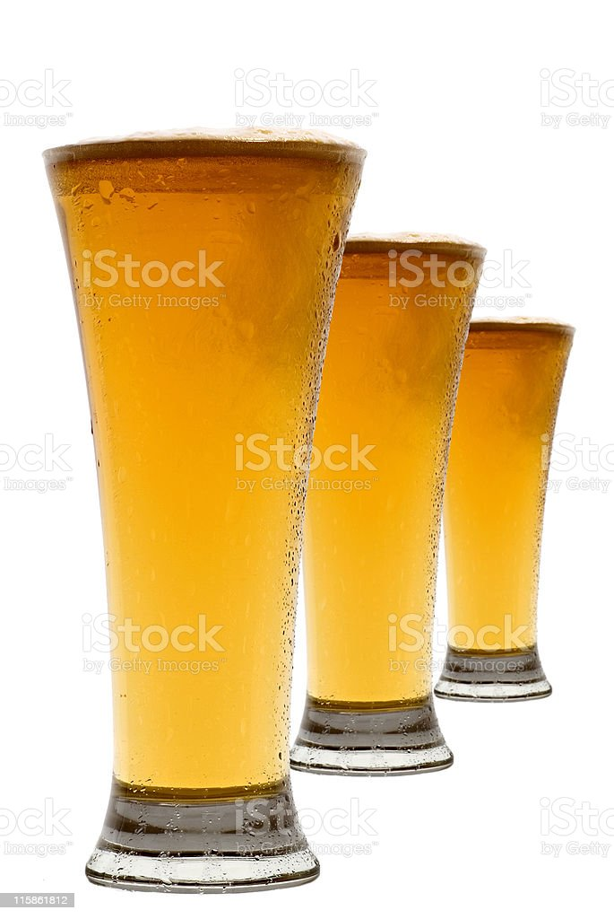 Three diagonal beer glasses royalty-free stock photo