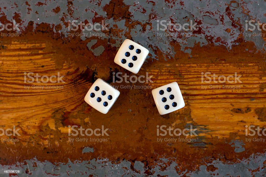 three dice with number six stock photo
