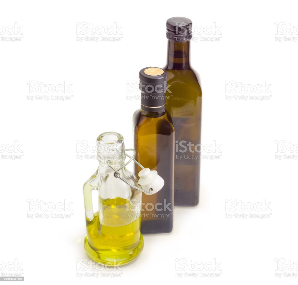 Three different bottles of various vegetable oil on white background stock photo