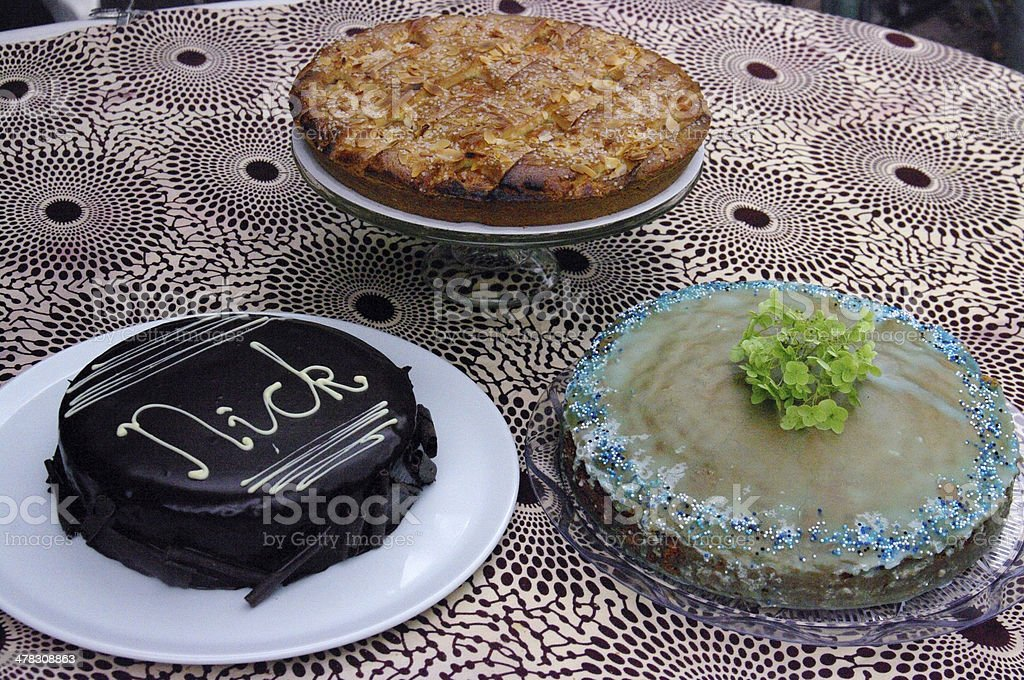 Three different cakes on a desk royalty-free stock photo