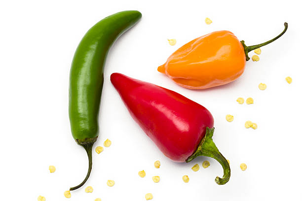 Three different colored and shaped peppers isolated on white Traditional Mexican spicy peppers jalapeno pepper stock pictures, royalty-free photos & images