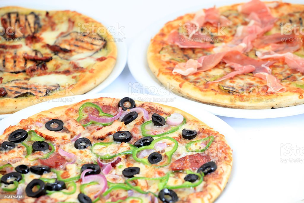 three different kind of pizzas stock photo