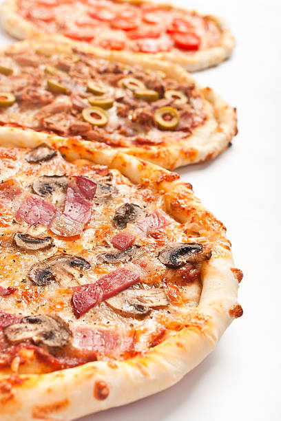 three different kinds of pizza stock photo