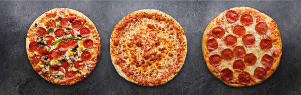 three different pizzas in panoramic composition three different pizzas in panoramic composition on dark surface pizza stock pictures, royalty-free photos & images