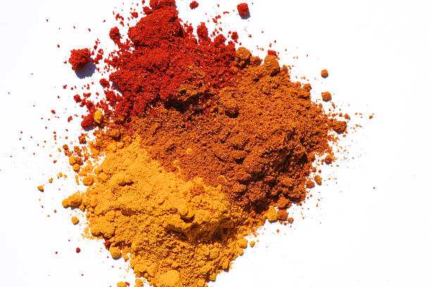 Three different powdered spices in a white background Colorful spices garam masala stock pictures, royalty-free photos & images