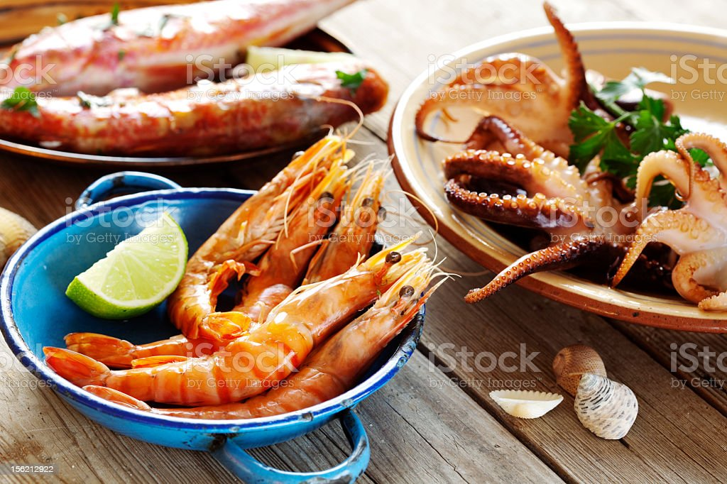 Three different seafood platters with fresh ingredients  stock photo
