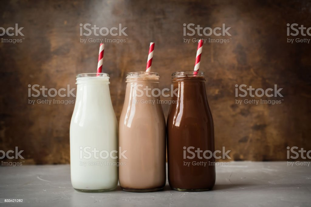 Three Different Sorts Beverage Bottle Wooden Background stock photo