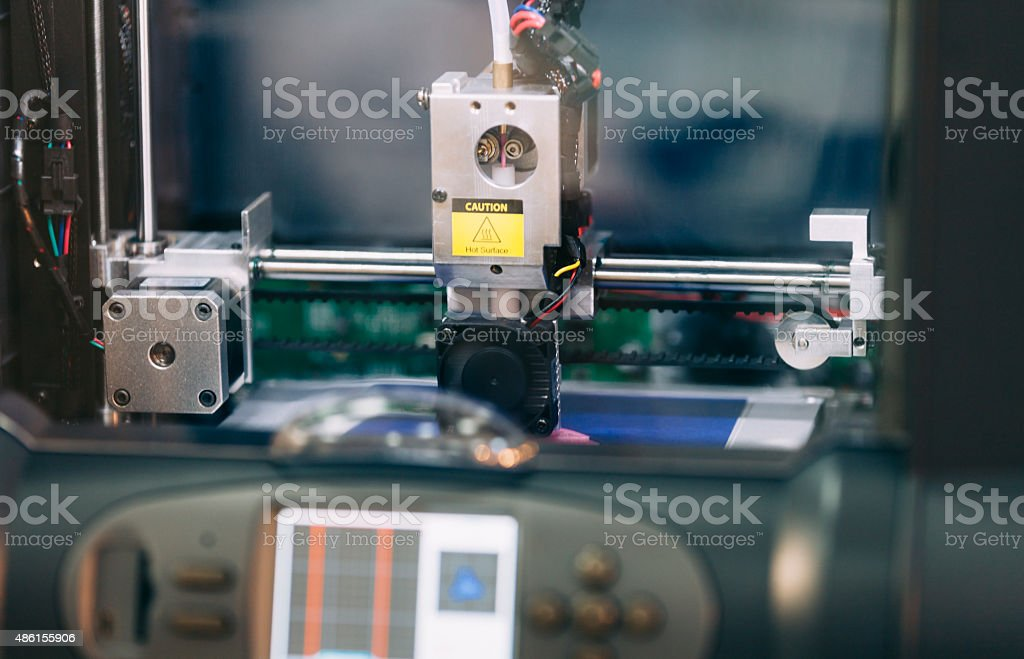 Three dimensional 3D printing machine in action stock photo