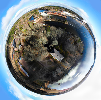 A three dimensional panoramic view of hydroelectric power generation plant in Anjala at Kymijoki river, Finland. Mini planet panorama style.