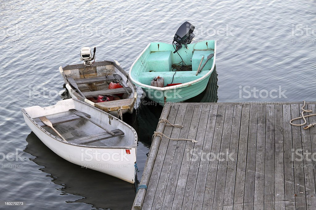 Three Dinghy Tied to a Pier royalty-free stock photo