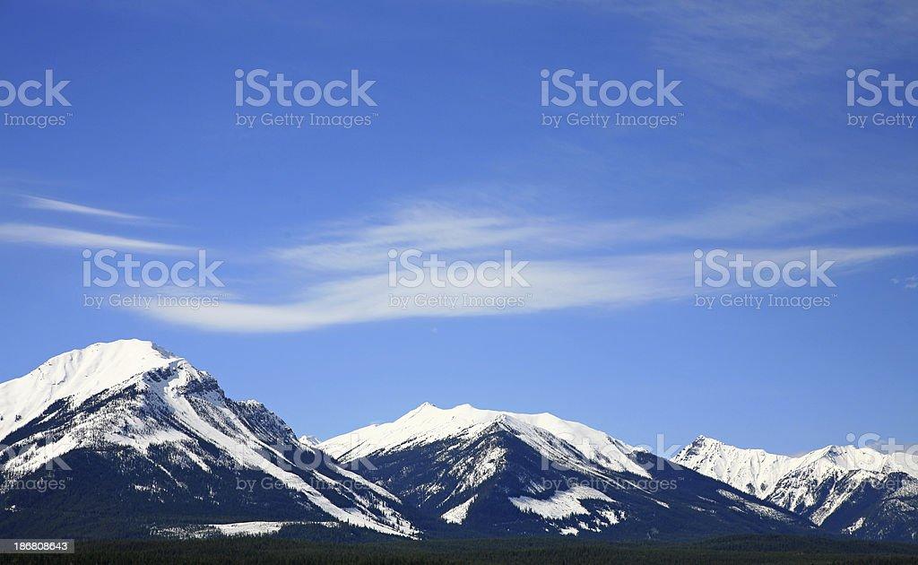 Three Distant Mountains With Snow. stock photo