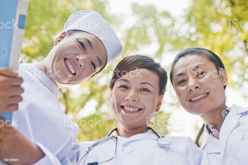 Three Doctors Looking Down at Camera royalty-free stock photo