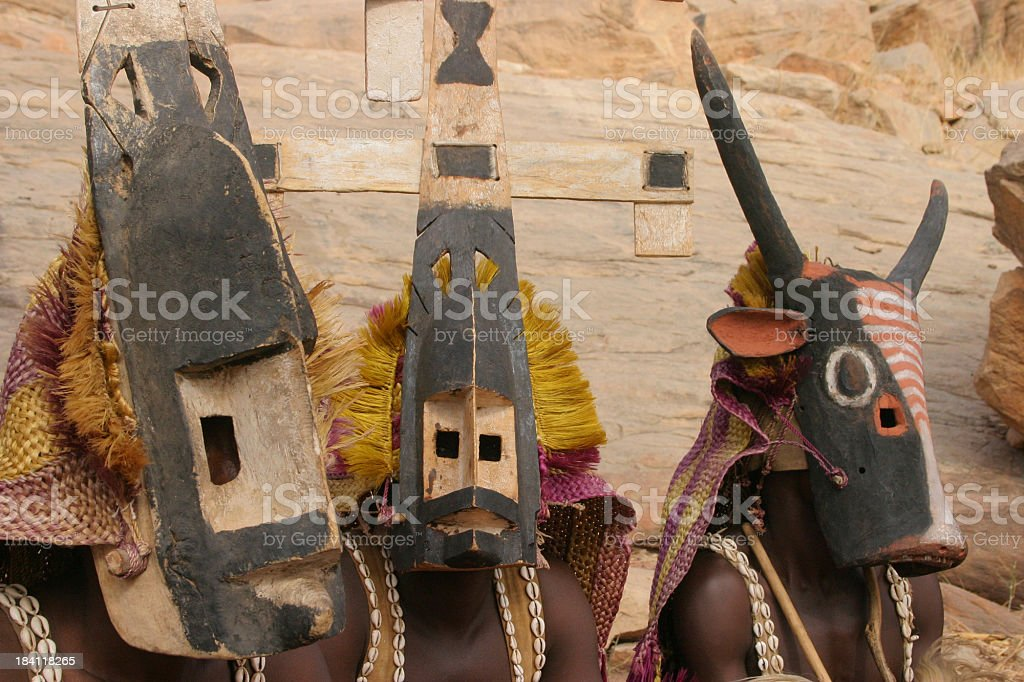 Three Dogon Dancers with Animal Masks stock photo