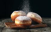 istock Three donut sprinkled with powdered sugar 537335382