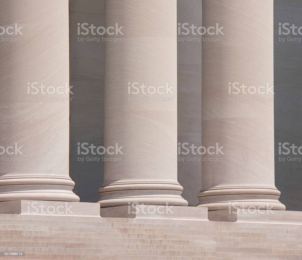 Three doric columns outside a courthouse. stock photo