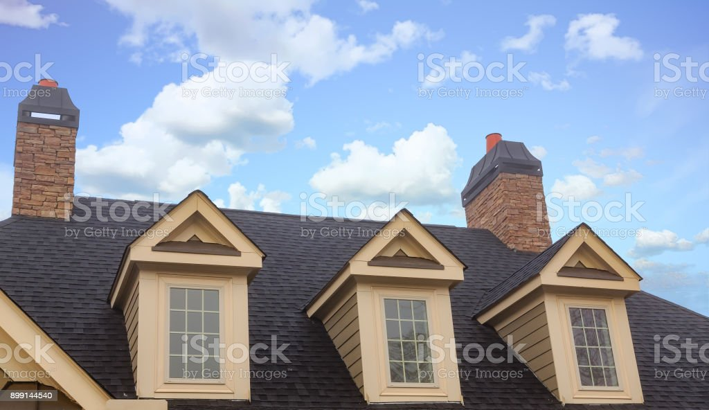 Three Dormers and Two Chimneys stock photo