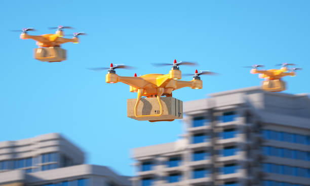 Three drones carrying a parcell stock photo
