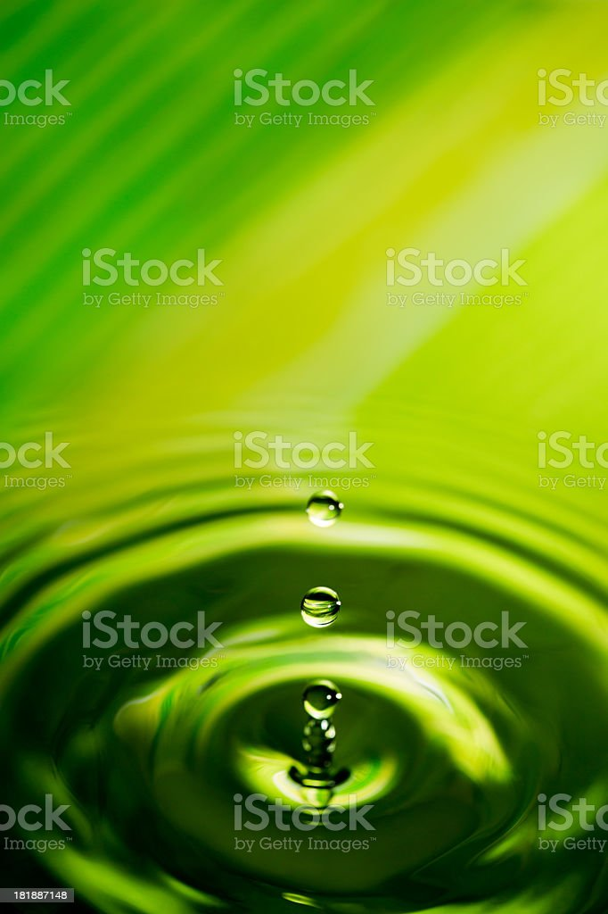 Three drops of water splashing into lake royalty-free stock photo