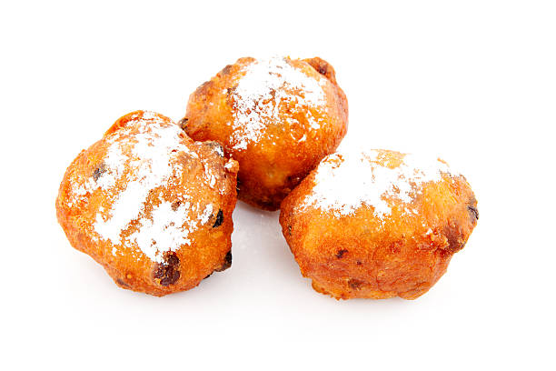 three dutch donut also known as oliebollen - oliebollen stockfoto's en -beelden