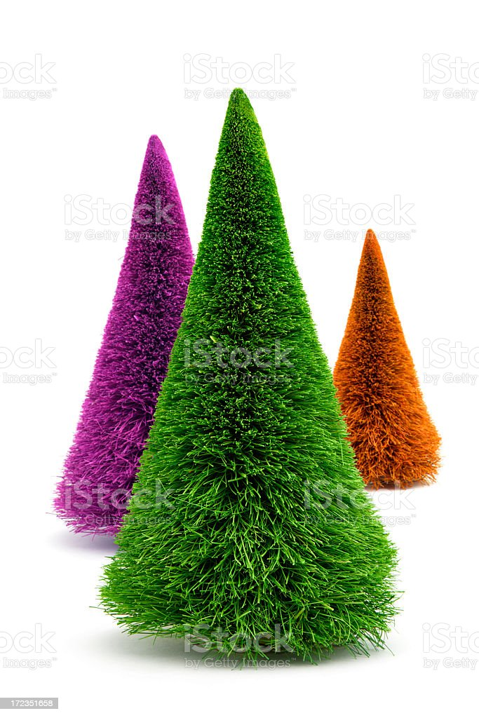 Three dyed Christmas trees on a white background royalty-free stock photo