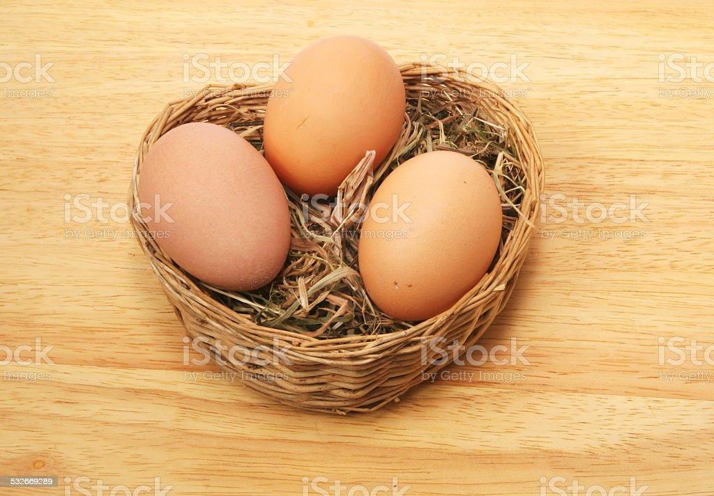 Three eggs in basket stock photo