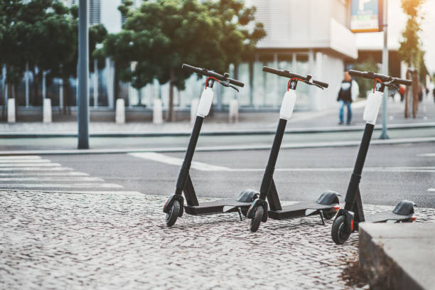 three electric scooters outdoors - electric push scooter stock photos and pictures