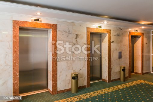 Three elevators in the hotel lobby. The interior of the building.