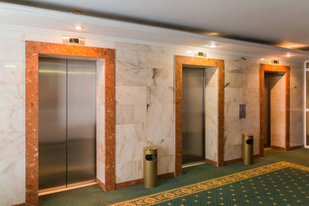 Three elevators in the hotel lobby. The interior of the building stock photo