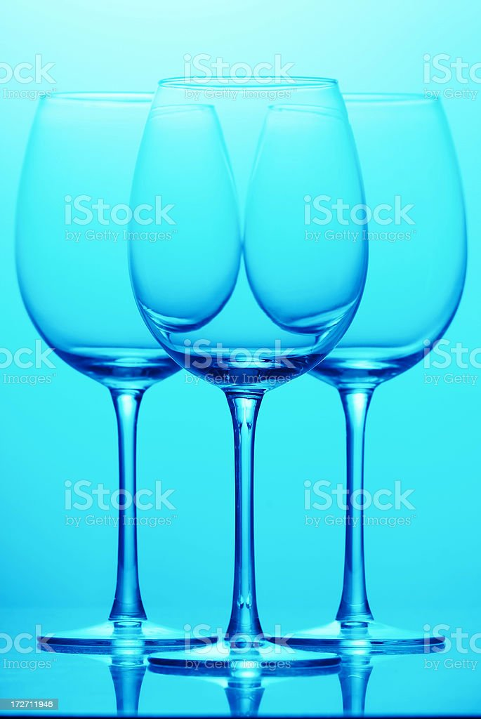 Three empty glasses in cyan royalty-free stock photo