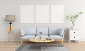 Three empty photo frame for mockup in white living room, 3D rendering
