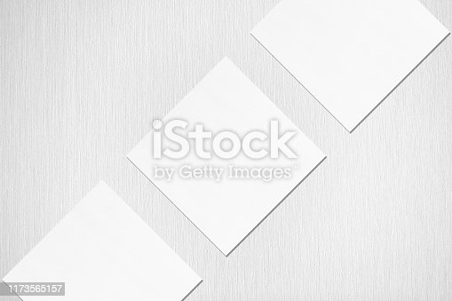 1173565159 istock photo Three empty white square business card mockups with soft shadows lying diagonally 1173565157