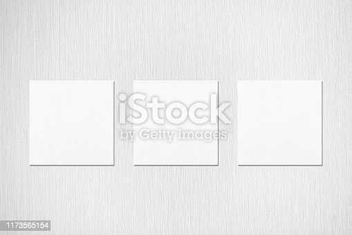1173565159 istock photo Three empty white square flyer or business card mockups on neutral light grey textured background 1173565154