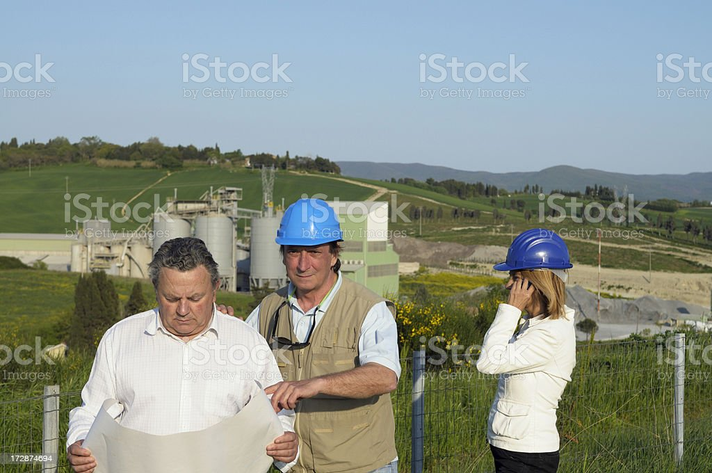 Three engineers and new agricultural building royalty-free stock photo