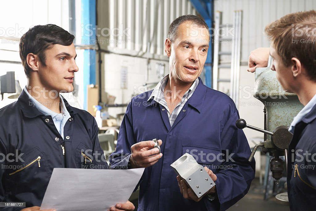 Three engineers at factory royalty-free stock photo