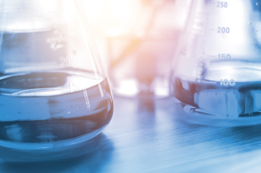 istock three erlenmeyer flask , Glassware on  science laboratory research and development 926784618