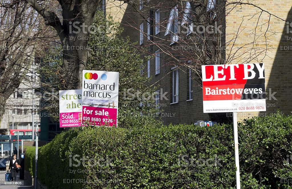 Three estate agents' signs royalty-free stock photo